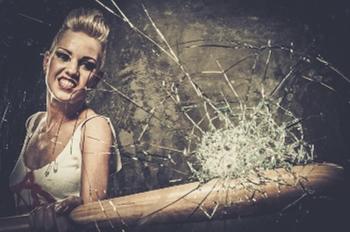 girl breaking windshield with baseball bat