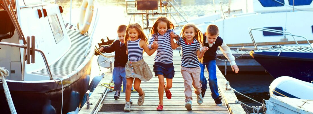kids running on a dock in the marina