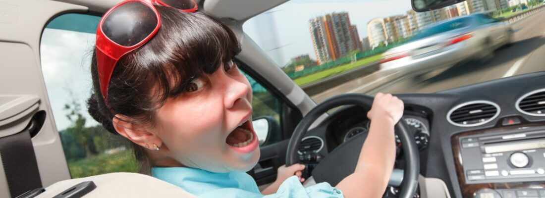 woman-surprised by a rock chip on her windshield